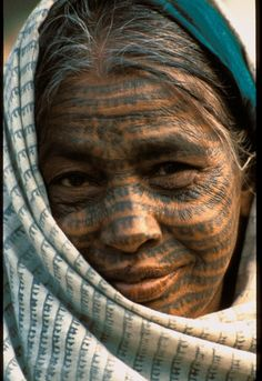 India |  Portrait of a Ramnami Samaj woman.  {This website has lots of pictures of this special religious and social movement in India, where believers get the name of Ram tattooed across their faces, bodies and even their tongue.