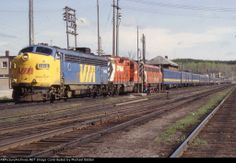 Train 1 at White River behind a mix of VIA and CP power.  Date: 5/26/1981 Location: White River, ON CA