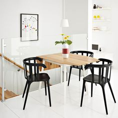 IKEA PS 2012 drop-leaf table in bamboo/white seats 2-4 with IKEA PS 2012 black chairs with armrests
