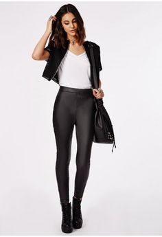 These smokin' high waisted faux leather leggings feature two gold front zips for that hot hint of bling. You'll deffo be in in the mood for killing it on the dancefloor in these slick beauts. Style yours with a rad crop top and plenty of go...
