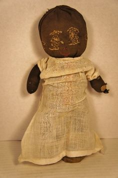 Early little black sock doll as found with great eyes