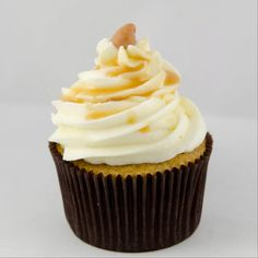 Caramel Apple-Apple spice cupcake topped with vanilla cream cheese frosting and caramel.---Sweetly Smitten