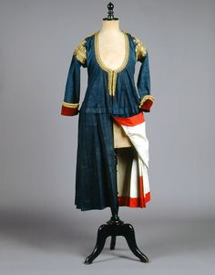 """Kaplamas"". The everyday indigo dyed coat dress of Megara, a village northwest of Athens, lined with white and red cotton lining, when worn, was often pulled at the back.  Size 	  Date 	Early 20th c."