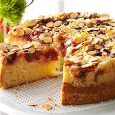 Cherry-Almond Coffee Cake Recipe -Every Christmas morning, I bake a coffee cake that's rich and creamy like a cheesecake. My family loves cherries on top, but make it yours with any kind of fruit preserves. —Sue Torn, Germantown, WI