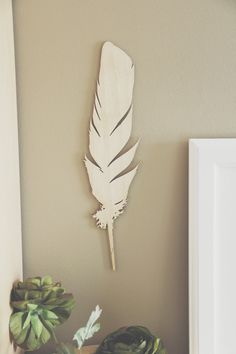 MADE TO ORDER /// Allow One Week  Simple but beautiful, this feather will look great on any wall or laid flat on a shelf or table.  If you love crafts try dipping it in gold or painting it white!  Please note since this is real wood the texture of each plate may vary slightly.  Material: 1/8in birch plywood Size: 14 x 3.70 Finish: protective oil or unfinished (choose on purchase)  Interested in getting it engraved? Send me a message!  NOTE: Adhesive for wall not included. Its light weight…
