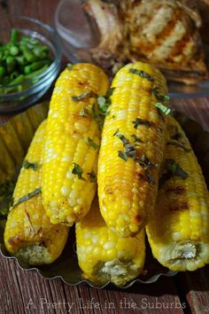 Basil Butter Roasted Corn on the Cob... Freaking amazing. Used oven instead of grill, but still perfect