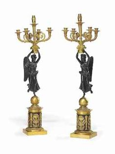 A PAIR OF EMPIRE ORMOLU AND PATINATED BRONZE FIGURAL FIVE-LIGHT CANDELABRA  EARLY 19TH CENTURY.