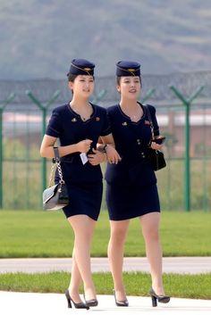North Korean plane crew Air Hostess Uniform, Life In North Korea, Airline Uniforms, Female Pilot, Flight Attendant, Airline Attendant, Tights Outfit, Cabin Crew, Models
