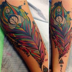 Colourful feather tattoo by Katie Shocrylas