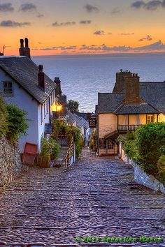 "Clovelly, England. ""oh, I live over yonder by the two oaks past the tavern,"" -something I've always wanted to say"