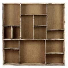 Wood bookcase with a weathered finish and 14 compartments in assorted sizes.