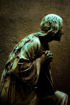 Prayerfully....look at the hair trailing down her back.  Such beauty in the world.    Cimitero Monumentale, Milano