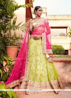 Everyone will admire you when you wear this clad to elegant affairs. Look stunningly beautiful in this pink and green net, jacquard and georgette a line lehenga choli. This attire is showing some real...