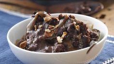Ooey gooey chocolate pudding, caramel and pecans make this slow cooker dessert extra delicious.