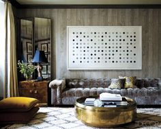 That sofa and that table, rug and art.