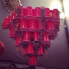 Red Solo Cup Chandelier-- maybe we can add to it throughout the weekend like flowers, leaves, etc? or flip it upside and make like an alter/offering area? Redneck Birthday, Redneck Party, 50th Birthday Party, Birthday Ideas, Solo Cup Crafts, Red Cup Party, Trailer Trash Party, Hillbilly Party, Redneck Christmas