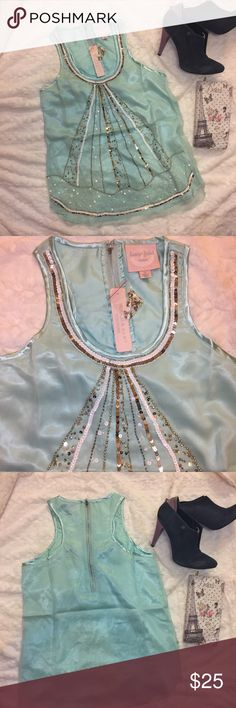 Romeo & Juliet Couture beaded top Tiffany blue S Beautiful Romeo & Juliet Couture beaded top Tiffany blue Size small. New with tag. Retail price $175 Romeo & Juliet Couture Tops Blouses