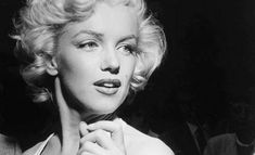 sad Marilyn Monroe    Men are climbing to the moon but they don't seem interested in the ...