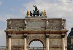 This photo shows the west facing facade of the Arc de Triomphe du Carrousel, showing the back of the quadriga statue as well as many other details to admire.  Daily updates at www.eutouring.com/images_arc_de_triomphe_du_carrousel.html