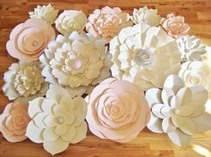 Use these Paper Flowers to make an amazing Paper Flower Wall or Flower Backdrop for your home decor, Baby Nursery, Wedding, Bridal Shower, Baby Shower or other Social Event. In your home as paper flower art use it like a painting over your sofa or a backboard over your bed. Use it
