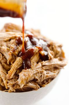 Pressure Cooker BBQ Pulled Pork is an easy three ingredient recipe made in your Instant Pot! This tender and delicious pork is perfect for sandwiches or wonderful paired with rice and vegetables for a healthy dinner idea.