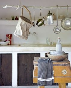 {Hang a painted branch from two ropes in your kitchen and use to display / store utensils, pots, pans, etc.}