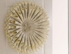 How to Make a Paper Wreath - I could do this with the leftover pages from the book we've been crafting from!
