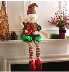 Place Kirkland's Ritzy Elf Shelf Sitter on your mantle for a fun Christmas addition! He's dressed in a metallic green and red suit and has jingle bell boots. Plus, his arms are wire, so he can strike a pose! Christmas Elf, Christmas Stockings, Christmas Wreaths, Christmas Ornaments, Christmas Things, Indoor Christmas Decorations, Whimsical Christmas, Holiday Decor, Merry Chritsmas