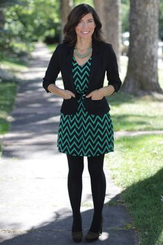 Teaming a bright dress with a black blazer