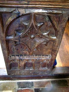 Northamptonshire, Yelvertoft - Pew ends probably 16th Century carved with Gothic tracery.