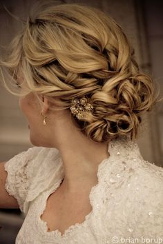 Bridal Hair - 25 Wedding Upstyles  Updos - Achieve this wonderfully styled upstyle by pinning your curls to the back of your neck and adding a signature hair accessory.