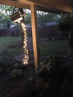 How to make a glowing watering with fairy lights! Get the fairy lights here  #wateringcanwithlights #wateringcan #springcraft #gardendecor #gardendecorations