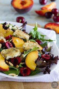 The perfect combination of sweet and savory, this Stone Fruit Salad with Fried Goat Cheese takes advantage of summer peaches and cherries and combines them with fried goat cheese coins that you'll want to add to every salad. Such a great summer salad!: