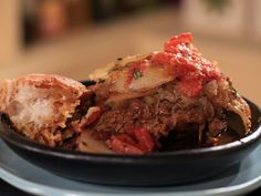 Grandpa's Braised Beef from FoodNetwork.com (I like the layered potatoes idea, gotta try it)