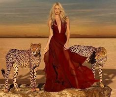 Shakira's in Piqué condition posing with cheetahs in scent ad