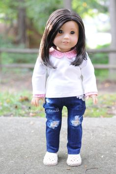 Top by Anick's Boutique, jeans by Clarisse's Closet and shoes by QTπ Doll Clothing. American Girl