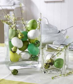 This Easter centerpiece idea couldn't be easier to pull off—just fill a glass vase with dyed eggs and a few flowering branches from your backyard. Pin it to your boards! » Get more information at Home Bunch   - CountryLiving.com