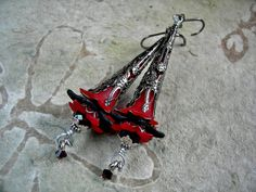 Elegantly long, these red & black Elven Wand earrings are deliciously gothic!