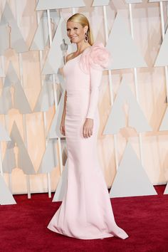 Paltrow is feminine in a blush Ralph and Russo dress with a floral touch.    - HarpersBAZAAR.com
