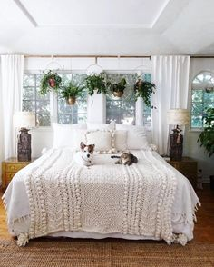 Eclectic Home Tour - love this Boho bedroom with plant window treatment and chunky knit blanket