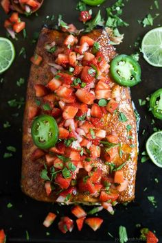 Spice Rubbed Cedar Plank Salmon topped with a refreshing Strawberry Salsa. This Salmon is the ultimate summer main dish and definitely a crowd pleaser! | joyfulhealthyeats.com #glutenfree