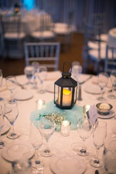 This #chandelier centerpieces is so simple yet so perfect for a seaside wedding {Oz Visuals}