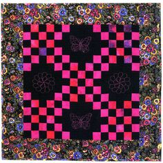 """Pink & Black Irish Chain, 31"""" x 31"""". Machine embroidered butterflies in the 4 black squares. From """"Bold, Black & Beautiful Quilts"""", AQS 2004."""