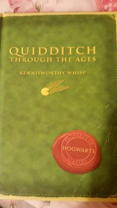 Book 18: Quidditch Through the Ages - trying to decide which team I'd root for.