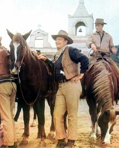 THE SONS OF KATIE ELDER (1965) - John Wayne & Michael Anderson with their horses on location in Durango, Mexico - Directed by Henry Hathaway - Paramount - Publicity Still.