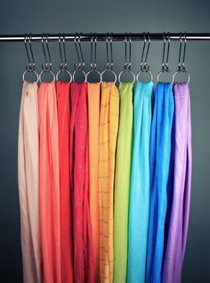 Decorative shower curtain rings can be attached to s-hooks to interchange scarves easily and create an extra dimension. Craft Show Displays, Craft Show Ideas, Store Displays, Scarf Display, Fabric Display, Showroom Interior Design, Boutique Interior, Denim Window Display, Retail Jewelry Display