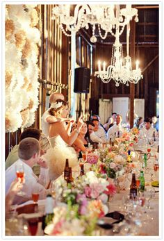 Barn yard wedding - complete with beautiful chandeliers and bright wedding flowers