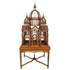 """A very impressive bird cage in grand scale! The piece has exquisite details and craftsmanship. The bird cage """"house"""" can be removed from the base. This was purchased at an auction in France around 2005. The piece dates back to 1870's in France, where a lot of artisans basically built these in hopes of getting a job working for someone wealthy in order to showcase their talents on that person's mansion."""