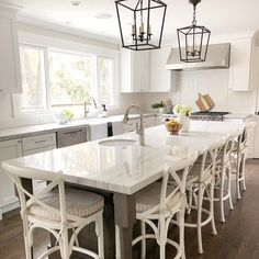 Kitchen Remodeling Trends White kitchen remodel with Macabus Quartzite island Dining Furniture, Furniture Stores, Sans Serif, Serif Font, New Kitchen, Kitchen Decor, Kitchen Ideas, Kitchen Layouts With Island, Kitchens
