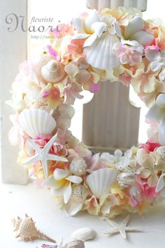 Plumeria Hydrangea shell wreath. Great inspiration for beach wedding decorations.